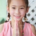 Closeup portrait of a cute girl praying — Stock Photo #12197527