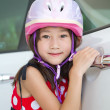 Close-up of a little girls  with a pink helmet — Stock Photo