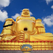 Buddha statue in chinese temple on blue sky — Stock Photo