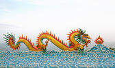Chinese dragon statue on the clouds. — Stock Photo