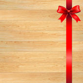 Red Bow And Blank Gift Tag With Wooden Wall — Stockvector