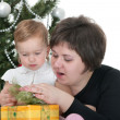 Mom and toddler at the new year tree — Stock Photo