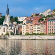 Colorful houses on emankment in Lyon — Stock Photo #13648714