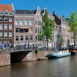 Historic houses along the Amsterdam canal — Stock Photo