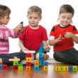 Stock Photo: Children playing on the floor together