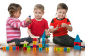 Children playing on the floor together — Stock Photo