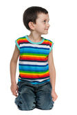 Looking away smiling little boy — Stock Photo
