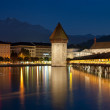 Night view on Chapel Bridge in Luzern - Stock Photo