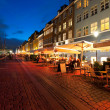 Small cafes on Nyhavn at night — Stock Photo
