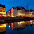 Old buildings in Nyhavn at night - Stock Photo