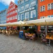 Houses with small cafes on Nyhavn — Stock Photo #15833211