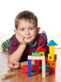 Serious little boy near toys — Stock Photo