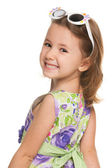 Cheerful little girl looks back — Stock Photo