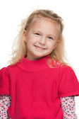 Closeup portrait of a little girl in red — Stock Photo