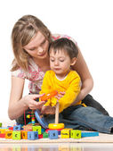 Mother and son on the floor with toys — Stock Photo