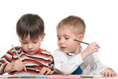 Little boys write at the desk — Stock Photo