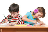 Children write at the desk — Stock Photo