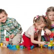 Three children are playing on the floor — Stock Photo
