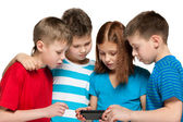 Children plaing with smartphone — Stockfoto