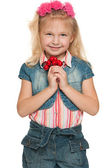 Little girl with red berries — Stock Photo