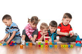 Five kids playing on the floor — Stock Photo