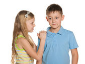 Smiling boy and girl are standing together — Stock Photo