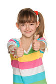 Cheerful girl holds her thumbs up — Zdjęcie stockowe