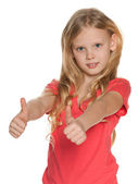 Pretty nordic girl holds her thumbs up — Stock Photo