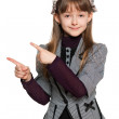 Young girl shows her finger to the side — Stock Photo