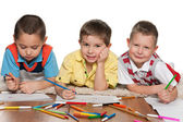 Cheerful boys drawing on paper — Stock Photo