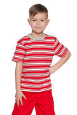 Smiling young boy in red — Stock Photo