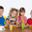 Children celebrate a birthday at the table — Stock Photo #23344720