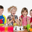 Children celebrate birthday at the table — Stock Photo