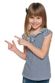 Laughing girl shows her fingers to the side — Stock Photo