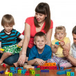 Happy family are playing on the floor — Stock Photo