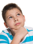 Looking up pensive boy — Stock Photo