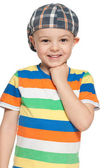 Cheerful little boy in cap looks forward — Stock Photo