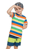 Fashion little boy in cap looks forward — Stock Photo