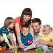 Family are playing with children on the floor - Stock Photo