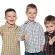 Royalty-Free Stock Photo: Three cheerful cute boys