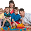 Happy family are playing on the floor — Stock Photo #24534141