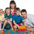 Happy family are playing on the floor — Foto Stock
