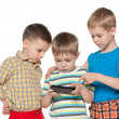 Little children plaing with smartphone - Stock Photo