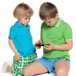 Two children plaing with smartphone — Stock Photo #24785573