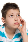 Looking up thoughtful boy — Stock Photo