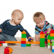 Two baby boys are playing — Stock Photo #30536797
