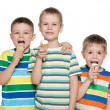 Boys are eating ice cream — Stock Photo