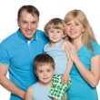 Family standing on the white background — Stock Photo