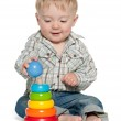 Cute baby boy is playing with toys — Stock Photo