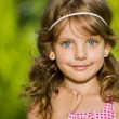 Portrait of a pretty little girl outdoors — Stock Photo